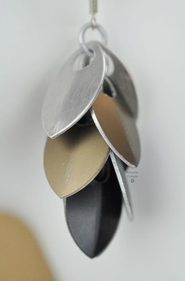 Smoke Dangling Shields in aluminum, by Infinitus Designs