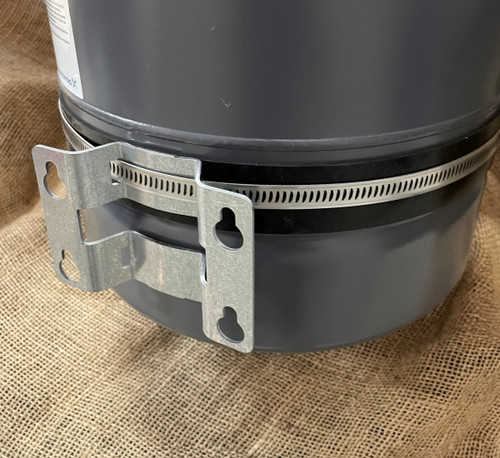 Steel mounting bracket for a steel accumulator tank with clamp and protective insertion rubber strip. B.