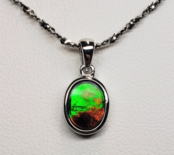 Petite Oval Ammolite Sterling Silver Pendant featuring a 7 X 9 mm Triplet Gemsto