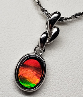 Classic Oval Ammolite Sterling Silver Pendant featuring a 7 X 9 mm Triplet Gem