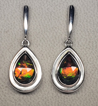 Silver Ammolite Earrings are unique designs set with vibrant and dramatic Pear S