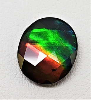 10 x 12 Ammolite Canada's Opal Faceted Oval Deep Green, Red and Blue