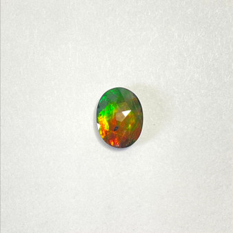 Faceted Oval Gemstone Deep Green & Hints of Orange