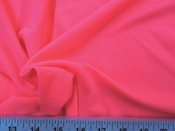 Discount Fabric Liverpool Textured 4 way Stretch Scuba Coral Pink LP09