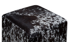 Black and white speckled cowhide cube
