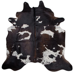 Black And White Reddish Cowhide Rug