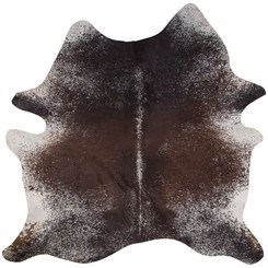 brown and white speckled cowhide rug