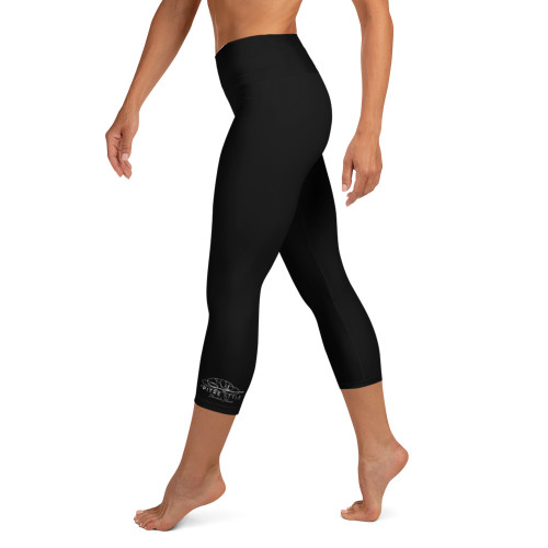 Pitre Style Fine Fashion Signature Black Comfort-band Yoga Capri Leggings. These yoga capri leggings with a high, comfortable elastic waistband are the perfect choice for yoga, the gym, or simply a relaxing evening at home. • 82% polyester, 18% spandex • Mid-calf length • Very soft four-way stretch fabric • Comfortable high waistband • Flat seam and cover-stitch.