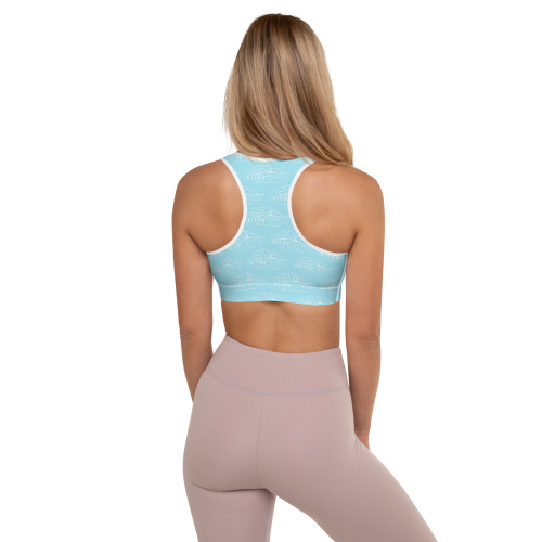 Feel like you're on Waikiki Beach in beautiful Oahu, Hawaii by wearing Pitre Style's Waikiki Blue Signature Padded Sports Bra. It is absolutely perfect for any activity from Yoga, casual wear, or sporting your workouts! Our sports bras are extremely comfortable, have a soft moisture-wicking fabric, extra materials in shoulder straps, and removable padding for maximum support and versatility. This Padded Sports Bra has a comfy cut that's perfect for low and medium intensity workouts. The extra material in shoulder straps and double-layered front provide all the necessary support. It will leave you feeling amazing all day long.