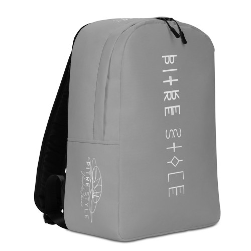 """Presenting the Mauna Kea Ash Grey """"Spine"""" Pitre Style backpacks designed in part by John Pitre, Casidy Rae and the Pitre Style team. If you feel like you're carrying half of your belongings with you at all times, this backpack is for you! It has a spacious inside compartment (with a pocket for your laptop), and a hidden back pocket for safekeeping your most valuable items."""