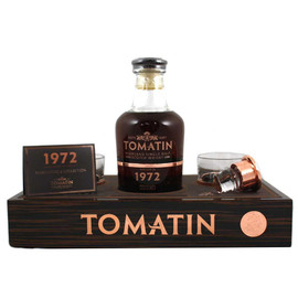 The second entry in Tomatin's Warehouse 6 Collection, this single cask was distilled in 1972 and produced to 380 bottles. Aged for 41 years, this has notes of almond, coffee and winter spices.The luxury wooden box includes a display plinth holding a hand-blown crystal decanter and two crystal tumblers, supplied by Scottish company Glencairn Crystal. The solid copper stopper and copper decoration are supplied by Scottish Silver.