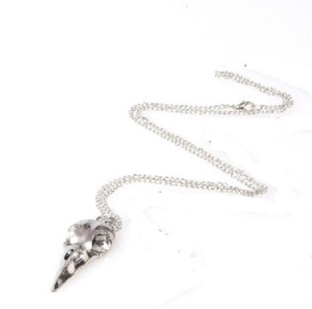 Two Crow Skull Pendants - Silver and bronze