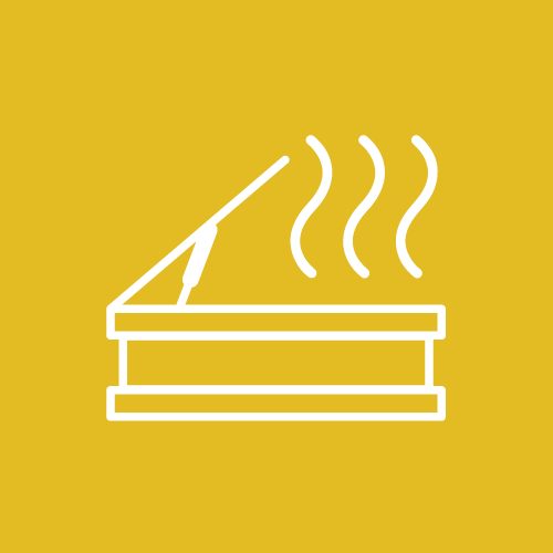 A yellow sign with an image of a vent with smoke coming out to represent our smoke vents