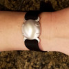 Satin wristband shield with band on women's arm