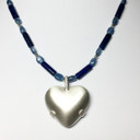 Empath's Bridge of Vision with Satin Level 2 BioElectric Shield Heart Empath's Bridge of Vision - Lapis Lazuli Tubes and Blue Kyanite ovals Kyanite and Lapis Lazuli is my favorite combination for Empaths and HSPs. It is a powerful combination in clarifying your vision, helping you remember the truth of who you are, protecting your energy field, balancing energy patterns and bringing your energy into cohesion and grounding.  Excellent tool for HSPS AND empaths and other highly sensitive people or healers to use; protecting and increasing your empathic and psychic abilities and allowing for more clarity in perception. HSPs and empaths often struggle to maintain a sense of self. The Lapis Lazuli strengthens your sense of self, moving you forward in your path to self-knowledge as you discover and learn to live from your true divine nature.  Experience divine inspiration in your heart as the energies of your soul spiral into your daily consciousness, flooding you with clarity, inspiration and the courage to live to your highest potential. Too often we play small, not stepping into our full truth – lapis calls your soul to step forward into its fullness, manifested here on the Earth plane. Feel your inner royalty and live from this heightened awareness of yourself as spirit.  Do you have something you need to say? Lapis opens both throat and brow chakras – bringing both your clear vision and your communication together so you can say just the right things, as if by magic.  In addition to seeing spiritual patterns, you may also find Lapis of assistance in identifying the karmic roots of disease facilitating breaking through old patterns and emotions that have been sabotaging your healing process.