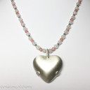 Love and Appreciation with Satin Level 2 BioElectric Shield Heart Love and Appreciation - Rose Quartz and Rhodochrosite Wearing this necklace takes you beyond love and into a realm of deep appreciation and resonance with all that is.  Love pure and simple, love yourself, love others, and in the process feel deep forgiveness, compassion, kindness and tolerance. Release grief, fear, resentment and anger as you reconnect with the perfection of yourself and all things. Reclaim your own innate talents and abilities left behind because of past wounds as you gain insight into issues of heart and will.   This combination may also help you release old patterns that keep you from feeling the love and beauty here on Earth - as you begin to move past the negativity into the love, you'll find it's easier to be grounded and connected.