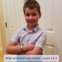 Cute boy wearing Wristband Shield with blue ID band