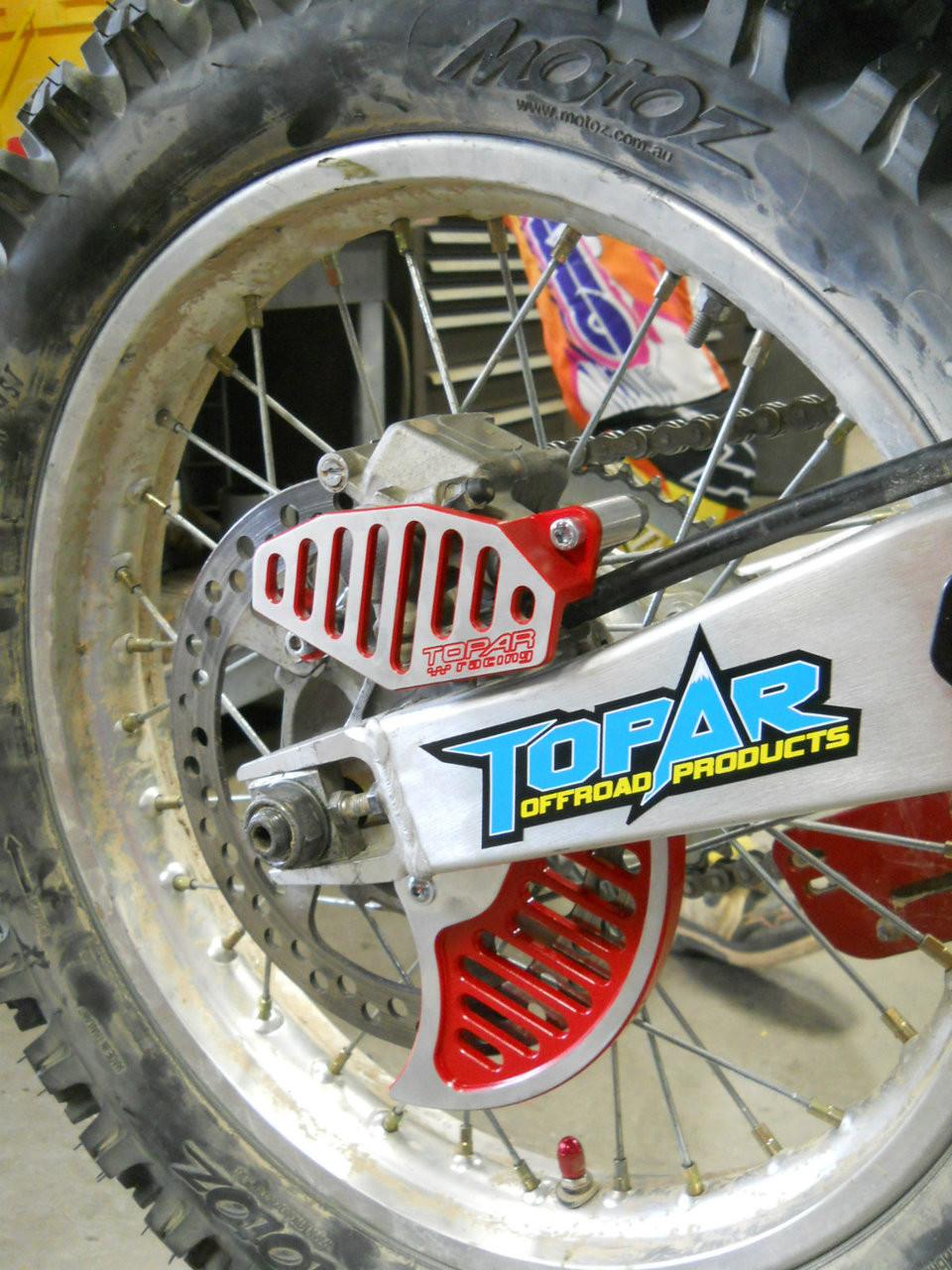 Topar Racing Rear Brake Rotor Disc Guard Fin for HONDA 1997-2001 CR125R, CR250R and 2000-2007 XR650R (MOUNTS TO OEM BRACKET)) SHOWN WITH 130-108-HCR BRAKE CALIPER GUARD