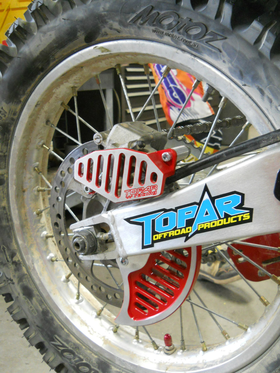 Topar Racing Rear Brake Caliper Guard for  2000-2007 XR650R (MOUNTS TO OEM BRACKET)  SHOWN WITH 101-102-HCR BRAKE DISC  ROTOR GUARD FIN