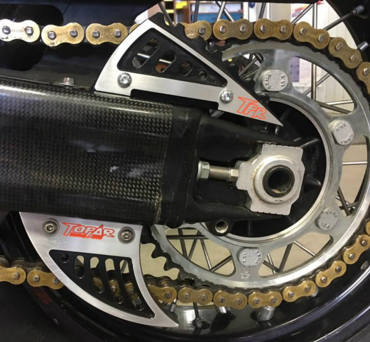 Topar Racing Chain Guard Fin Set fits 2003-2012 KTM 950 and 990 ADVENTURE - Shown here with Optional High Contrast Black EnduroCote Finish - CALL to order this option or for further information
