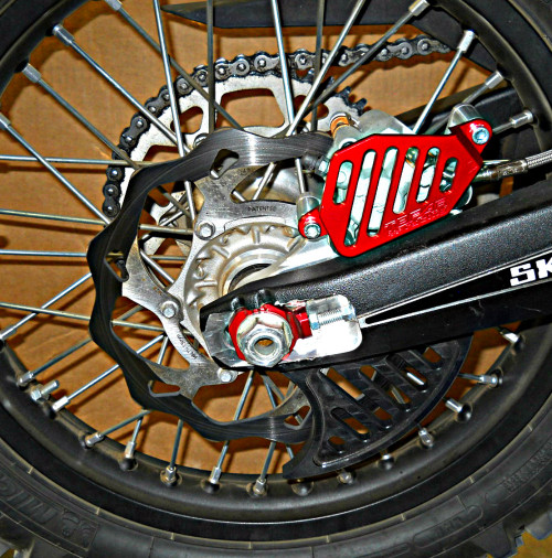Topar Racing Rear Brake Rotor Disc Guard for 2010-2019 BETA - All Enduro, X-Trainer, 2T, 4T, RR, RR-S and RS Models Shown Here with Optional UHMW Plastic Fin and Optional Caliper Guard in OPTIONAL RED EnduroCote FINISH - SPECIAL ORDER ONLY - CALL 719-846-9458 to order this RED Option and