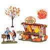 """While summer fades, bursts of autumn mark the landscape as pumpkins, gourds, and cornstalks welcome the new season. Set of 4 Includes: """"Best Deal Ever"""" accessory, maple tree, and bag of leaves. These 2 folks searched the who pumpkin patch."""