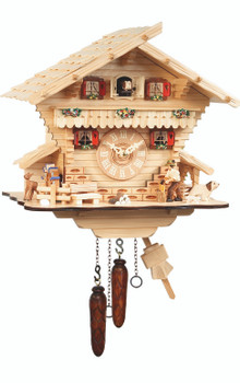 light colored wood cuckoo clock with wood chopper by engstler