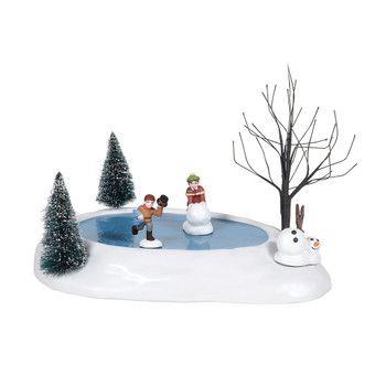 Village accessories, by Department 56. Add an extra touch to your Village display with Cross Product items. Building a Snowman, this animated Village accessory, hand-crafted, hand-painted, Polyresin. Adapter cord included. Two youngsters walk the yard gathering the supplies to create a snowman.