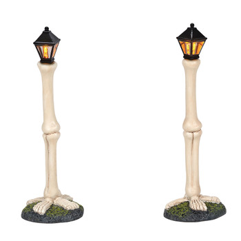 Set of 2 street lights for your Village display. Giant bones and tiny boned feet add a skeleton feel to your Village. This lighted accessory is hand-crafted, hand-painted, resin. Battery box included, 2 C batteries required.