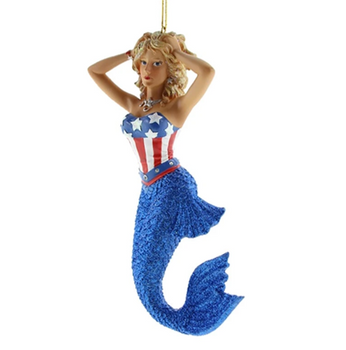 Star Mermaid by December Diamonds showcases the star and stripes on top of a fantastic sparkly blue tail. 90809