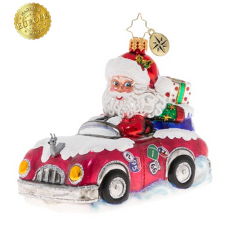 Road trip, anybody? Claus goes cross country in his sporty convertible and he's bringing Christmas cheer with him.