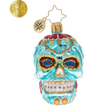 Swirling with colors and teeth that gleam, this sugar skull is quite dramatic. Whomever is lucky enough to get it as a gift is sure to be ecstatic!