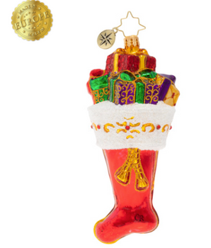 Inside there are wonders, candies, and trinkets to fawn over with glee. Anyone would be lucky to receive such a wonderful stocking, of that we all can agree.