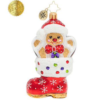 This isn't just any old stocking. This stocking has got quite a sweet surprise waiting inside—a jovial gingerbread man, and he's come to say hi!