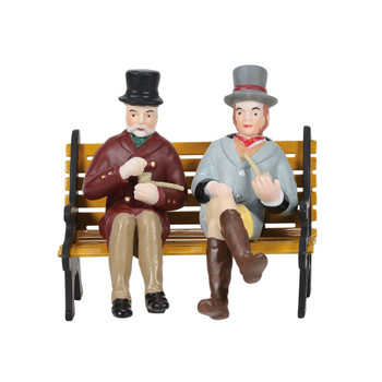 Set of 2, a couple of gents enjoy a pipe. Created to sit on bench or wall, bench not included. This Village accessory is hand-crafted, hand-painted, porcelain. Bench sold separately.