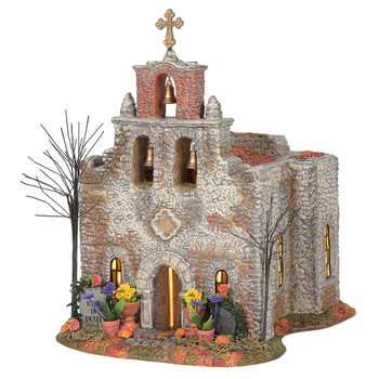 Day of the Dead, celebrated Nov 1 and 2, is a time to honor our family members who have passed. This occasion is filled with candle light, bright decorations, flowers and religious symbols. This church is traditional Spanish Mission Style architecture.