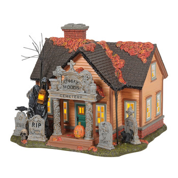 One of the spookiest additions to Trick or Treat Lane, The Cemetery House features a archway façade, yard full of tombstones, and visit from the Grim Reaper. Black cats, sculls and crows are not to be overlooked at this over-decorated house.