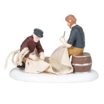 After a windy day on the water, an elder sailor shows a younger lad how to check for areas of the sails and lines in need of repair. Crafted with real cloth and ropes. This Village accessory is hand-crafted, hand-painted, porcelain.