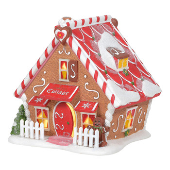 Magical elves have built a sweet neighborhood inspired by the gingerbread houses they create for Christmas. Ginger's Cottage includes peppermint trim, scrolled icing, and an oversized gingerbread man to turn up the charm on this cozy A-frame.