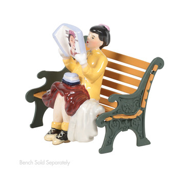 "Girl reading the ""Saturday Evening Post"" gives the illusion of being a cover girl beauty. This Village accessory is hand-crafted, hand-painted, ceramic. Bench sold separately."