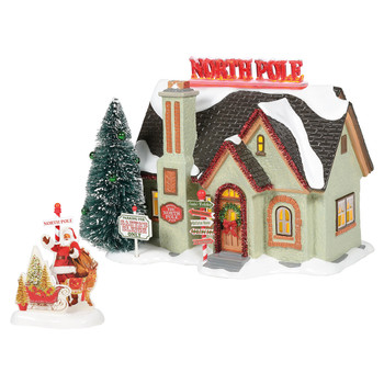 This neighbor chose to theme their home 'North Pole'. A bright roof sign, red tinsel trim and decorated tree play off the directional sign-post and 'Sleigh Only' parking sign. Oversized vintage lawn decor highlights the lit North Pole in the yard.
