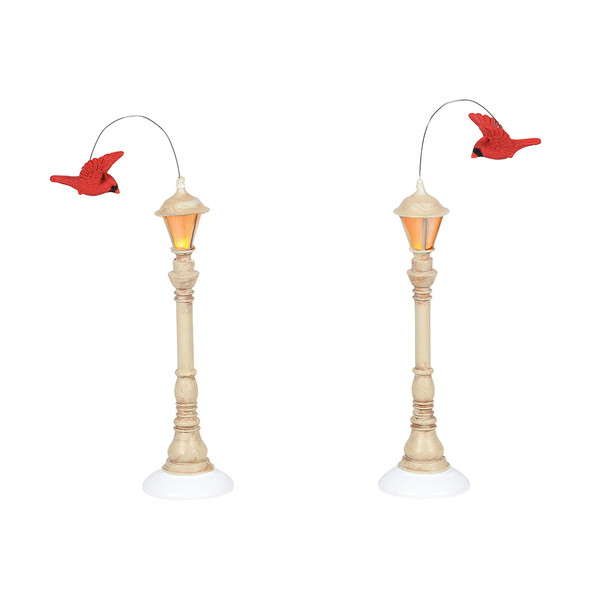 Set of 2 street lights for your Village display. Winter white lamps add a perfect compliment to a pair of red cardinals. This lighted accessory is hand-crafted, hand-painted, diecast. Battery box included, 2 C batteries required.