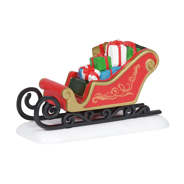 A beautiful sleigh holding gifts makes a perfect addition to your Village display. This general accessory is hand-crafted, hand-painted, resin.