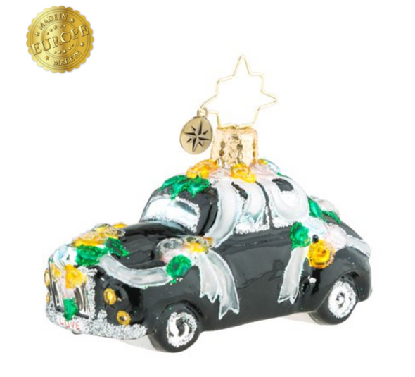 As if the holidays weren't enough to celebrate, committing your love in matrimony seals the deal. Drive off into your exciting future with this adorable keepsake.
