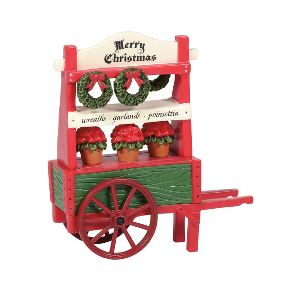 The charming cart adds holiday life to a Village park scene. This general accessory is hand-crafted, hand-painted, resin.