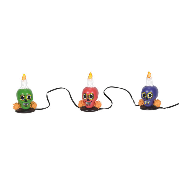 Set of 3 yard luminaries, colorful with candles and marigolds, these tiny skulls are great for your Day of the Dead Village displays. This general accessory is hand-crafted, hand-painted, resin. Battery box included, 2 C batteries required.