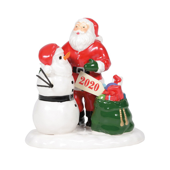 Santa is filled with glee to find a snowman in his likeness. Dated 2020.This Village accessory is hand-crafted, hand-painted, ceramic.