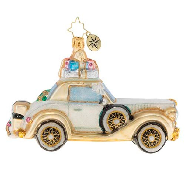 The happy couple takes off after their wedding in this wedding bliss chariot! Their gifts stacked high atop the roof and their bags packed for a honeymoon of memories at the back, this loving couple is ready for their happily ever after!