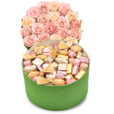 Grand flower gift box with paper pink and ivory roses cap, a green round box with pink ivory and gold wrapped chocolates