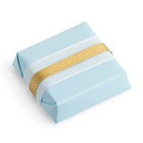 Square chocolate with light blue wrapping and overlapping blue and gold ribbons horizontal across chocolate